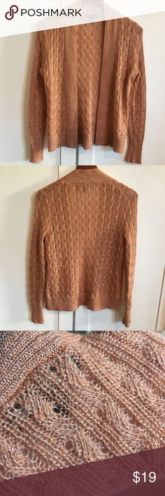 Banana Republic Rose Gold Metallic Sweater Banana Republic Rose Gold Metallic Sweater. This is a re-posh that didn't fit me.  Size tag says Medium but I think it fits more like a Small. Ask for measurements if you want to judge for yourself!  Beautiful Rose Gold color!  Make me an offer 😉 Banana Republic Sweaters Cardigans