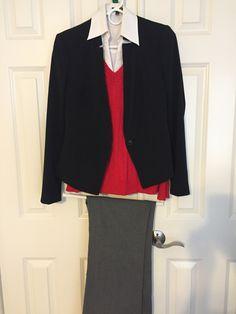 Gray pant, white collar shirt, red sweater, black jacket