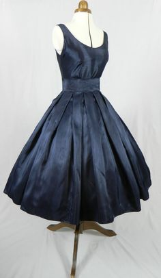 Another of our super elegant lovelies in navy shantung, made to order to your custom specifications. $285.00, via Etsy.
