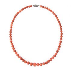 This Victorian era necklace is composed of sixty-seven graduated coral beads. They are deep orange in color and range in size from 4.95 to 8.40mm. The necklace is petite in length at 13 3/4 inches.