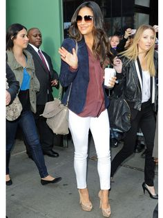 Shay Mitchell perfectly paired white jeans and nude platform heels with a dusty rose top and blue blazer.