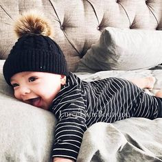 Precious little baby with adorable pom pom beanie!! #ad
