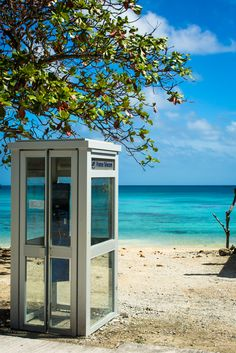 It's always fun so see a phone booth at the far side of the world with quite a nice view. Rotoava village in Fakarava atoll, Tuamotus, French Polynesia