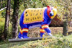 Cherokee Alphabet Black Bear - photo by Brent Moore [SeeMidTN.com (aka Brent)], via Flickr;  In and around Western North Carolina in Cherokee areas are several different Black Bear statues painted with different themes. This one was located near the eastern end of the Cherhola Skyway and Robbinsville, NC.