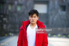 Stock Photo : Young man standing and looking