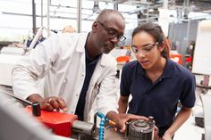 Engineer showing equipment to a female apprentice, close up royalty-free stock photo Social Policy, Hiring Process, First Job, Job Opening, Education College, Free Training, School Fun, Engineering, Stock Photos