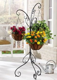 A simple, inexpensive element - 3 Arm Plant Stand. We move ours around the deck & patio wherever a burst of color is needed... always get lots of compliments.