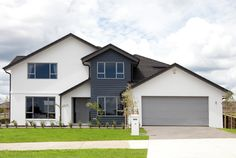 """This homes roofing is Gerard Corona Shake Metal tiles in Charcoal with Coloursteel fascia and powdercoated alumnimium downpipes in """"Ironsand"""""""