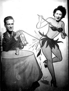 Vintage novelty arcade photo - man with soda syphon and exotic dancer.