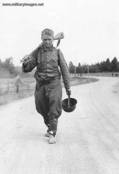 Soldier of 4th Armygroup is walking with bare feet at north of Viipuri.Finnish Army