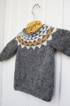Grey baby jumper/ sweater with yellow & white triangle details around the neckline.