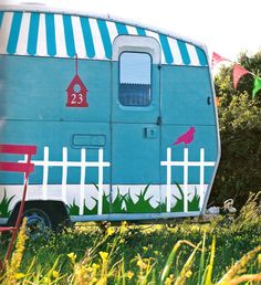 """camper painted with a """"yard"""" background"""