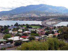 The Tasman Bridge spanning the River Derwent with Mt Wellington in the background. Downtown Hobart laid out under the mountain. Unique in Australia