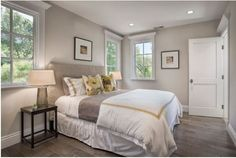 Benjamin Moore Edgecomb Gray ~ a greige, a warm gray. It is still a cool tone but has a warm undertone. The trim color is Benjamin Moore Decorator White in semi-gloss finish