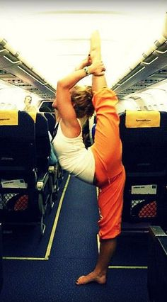 This how I usually stretch before my flight takes off.  I also do this stretch before playing tennis.  LOL!!!!!!!!!!!!!!