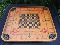 Carrom board   http://www.hilinski.net/woodgames/inventory/Carrom_rules.pdf