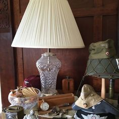 Beautiful vintage classic lamp. Art Deco elegance with military items. #artdeco #lamp #glass #elegance #vintage #military #militaryhat #helmet #warandpeacerevival #warandpeace #countryhouse #1920s #1930s #1940s http://ift.tt/1KwB1Ie