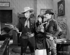 From left to right Tim McCoy Joan Crawford and Rex Lease in 'The Law of the Range' directed by William Nigh for MGM 27th October 1927