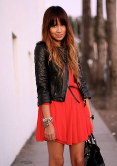 Summer party outfit - red dress with black leather jacket and handbag and belt.
