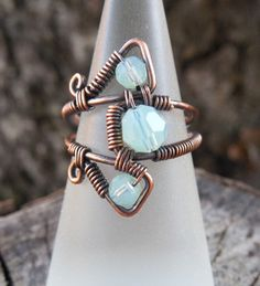 This handmade wire wrapped ring has a mystical and mesmerizing look to it that you will love. A quirky new age ring with an eye-catching and cool