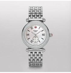 Caber Diamond, Diamond Bracelet  One hundred and forty glittering diamonds encircle this classic timepiece. Roman numerals and the signature Michele logo grace the mother of pearl dial. The stainless steel diamond bracelet is interchangeable with any 18mm Michele strap.