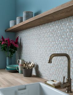 Tone down a busy mosaic with brass fixtures