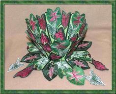 Lace Bowl & Doily  Caladium I was browsing through some pictures of caladiums I had planted in pots for my patio several years ago and had to make designs of them. There is a companion set of regular designs, Caladiums. Since caladiums come in so many variations of greens, reds and pinks you can try all different combinations for these designs.