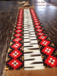 Close up view - Woven quill bracelet with caribou hide by Creations for Continuity.