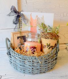 """""""Free Bird"""" Shabby Gift Basket Gift Basket contains: - Quality Wicker Basket - most perfect shade of Shabby Blue - Yankee Candle Vintage """"White Zinfandel"""" - Shabby Dresses on a Clothes Line Notebook w"""