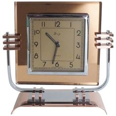 French Art Deco Streamline Modern Clock, copper, chrome, mirrored peach glass