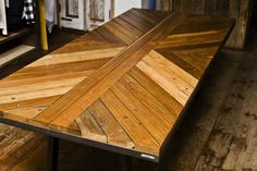 $14,000 table crafted by from reclaimed wood taken from the demolished iconic Coney island boardwalk. Only 10 will be produced.