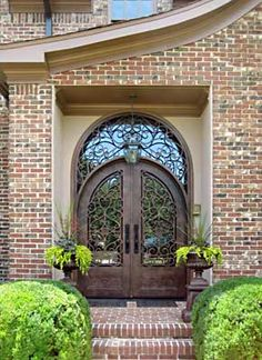 Salvage Oak Entry Door Round Top. Amazing double entry door rounded top with stunning wrought iron inserts.