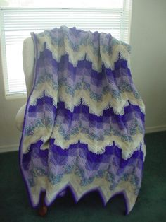 A pretty variation of a ripple afghan.