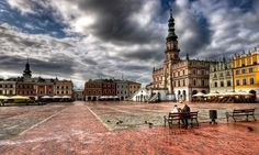 https://flic.kr/p/5Ub2Qt | The Old City quarter of Zamość - HDR | First attempt at creating a HDR photo with Photomatix.  Place Zamość was founded in the year 1580 by the Chancellor and Hetman Jan Zamoyski. Modelled on Italian trading cities, and built during the Baroque period by the architect Bernardo Morando, a native of Padua. Zamość remains a perfect example of a Renaissance town of the late 16th century, which retains its original layout and fortifications, and a large number of…
