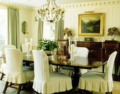 White dove walls, green silk curtains, and slip covered chairs for dining room.