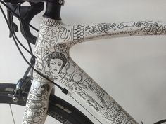 Illustrator Doodles On White Bicycle With Black Permanent Markers