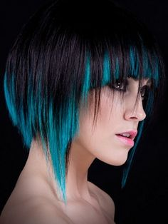 Beautiful cropped bob hairstyle with bangs and blue highlights