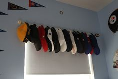 I didnt hang this to make the valance as shown...but I did hang all of the boys hats on an existing rod in the laundry room...perfect solution to the 5 million hats that we have. Total cost: $0