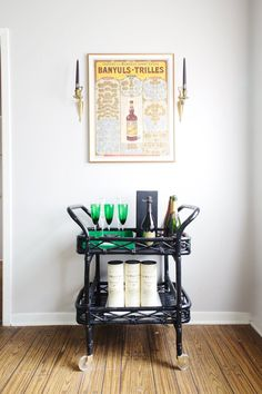 Maureen's Classic & Comfy Austin Abode. Extreme bar cart envy. Love those emerald green glasses!