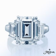 Are you looking for a simple and stunning engagement ring that stands out? This JB Star's platinum ring features a gorgeous 5.78 ct emerald cut H VS1 center diamond with two trapezoid cut diamond sidestones of 1.42 cts tw and straight baguettes of 0.42 ct. tw. on the shank. www.diamonds.pro