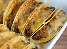 These are so tasty! My whole family loves them. I like to use the Stand and Fill taco shells. Tipping tacos is no fun! Also I get an aluminum casserole dish from the dollar store cause they are kind of messy. Use it and toss it.Found this recipe at www.http://blogchef.net/baked-tacos-recipe/