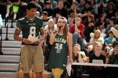 "Twelfth-grader Amelia Thompson, 17, student body president, rallies excitement during a homecoming assembly Sept. 25 at Falcon High School in District 49. Participation in spirit week surged this year, according Thompson. ""The leaders in our school aren't just in student council,"" she said. ""The leaders are also in gaming club, and in volleyball and football … and so, by getting their participation, we started a chain reaction from within the different clubs and teams."""