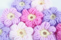 I did a video tutorial for the puff flower a while back, but a lot of you have been asking for the written pattern, so…