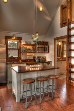 beautiful tiny kitchen but with snack bar table height for sitting in regular chairs...
