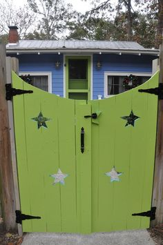 Jane Coslick Cottages wood fence colored gate