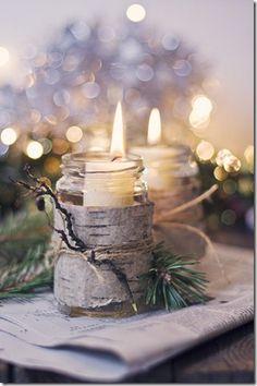 birch bark wrapped around mason jars secured w/ twine..... idea to note: add sprigs of cedar w/ juniper berries & small twig