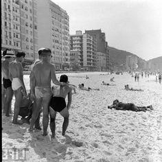 Golden days of Rio de Janeiro, Brazil. Men in Speedo posing on the beach.