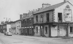 PH/17/3/23 Black and white photograph showing the Grey Horse Inn and the Park Road area of St.Helens, prior to redevelopment c1960s.    .PH - Photographic collections 17 - Photographic collections that were created by individual depositors 3 - Black and white photographs showing various streets in St.Helens