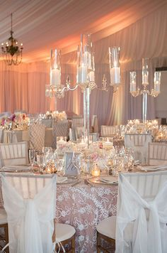 There's something about a candle that radiates romance. How beautiful is this table setting with tall candles as centerpiece! Check out this fabulous gallery.