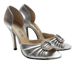 I saw these Manolo Blahnik heels in SATC and thus my love affair with shows began. And, the following year, for Christmas,my husband surprised me and gave them to me! And I wore those shoes into the ground!